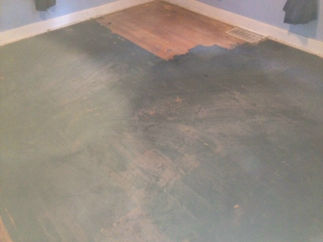 black stains from paint on a hardwood floor