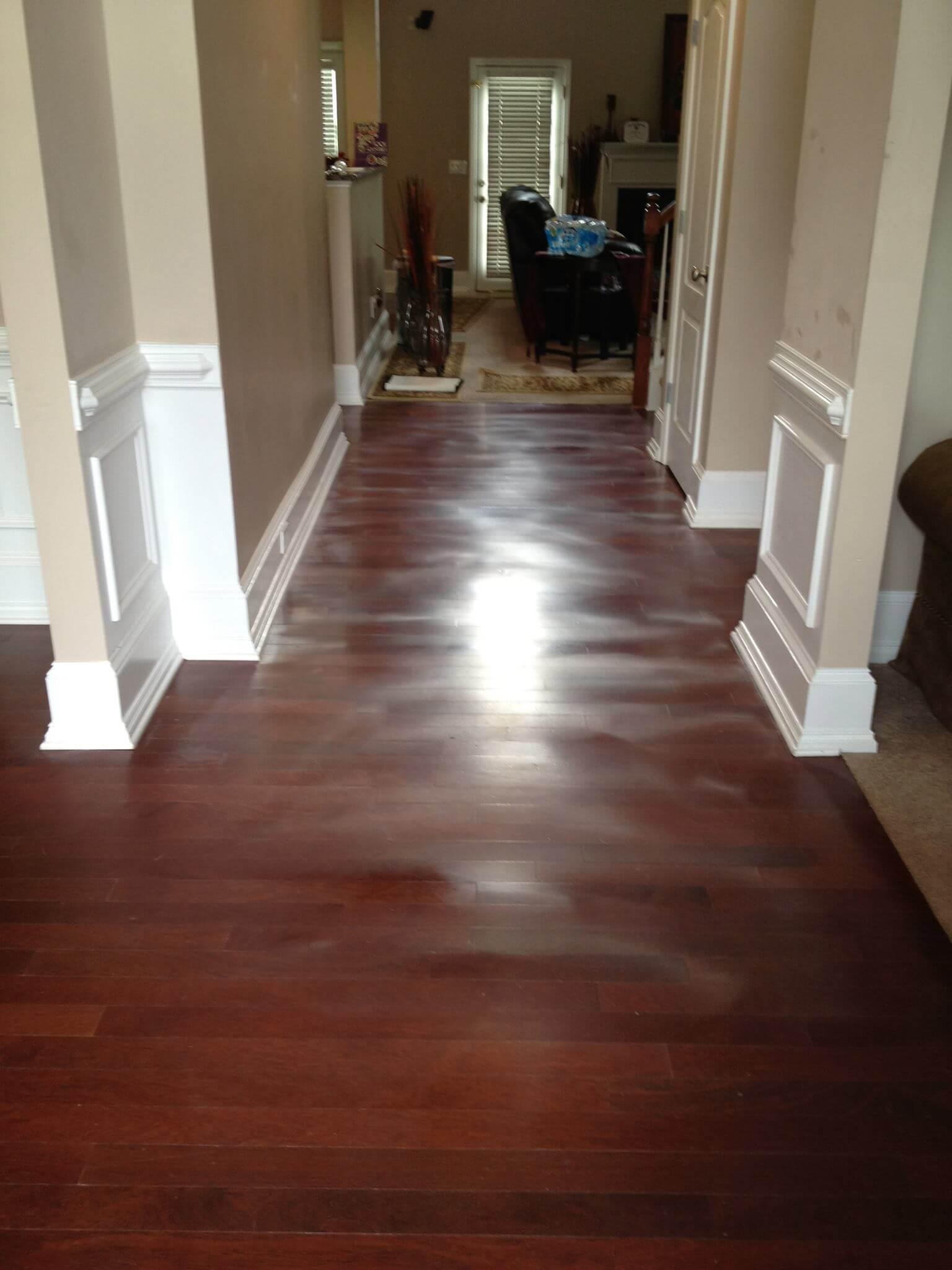 warping and red hardwood floor in need of fixing.