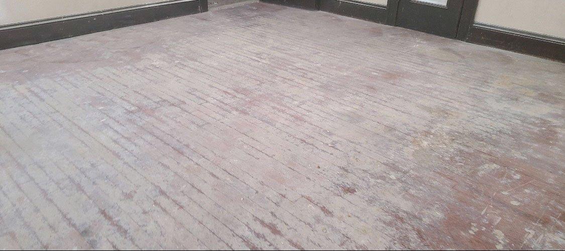 A damaged hardwood floor in need of repair